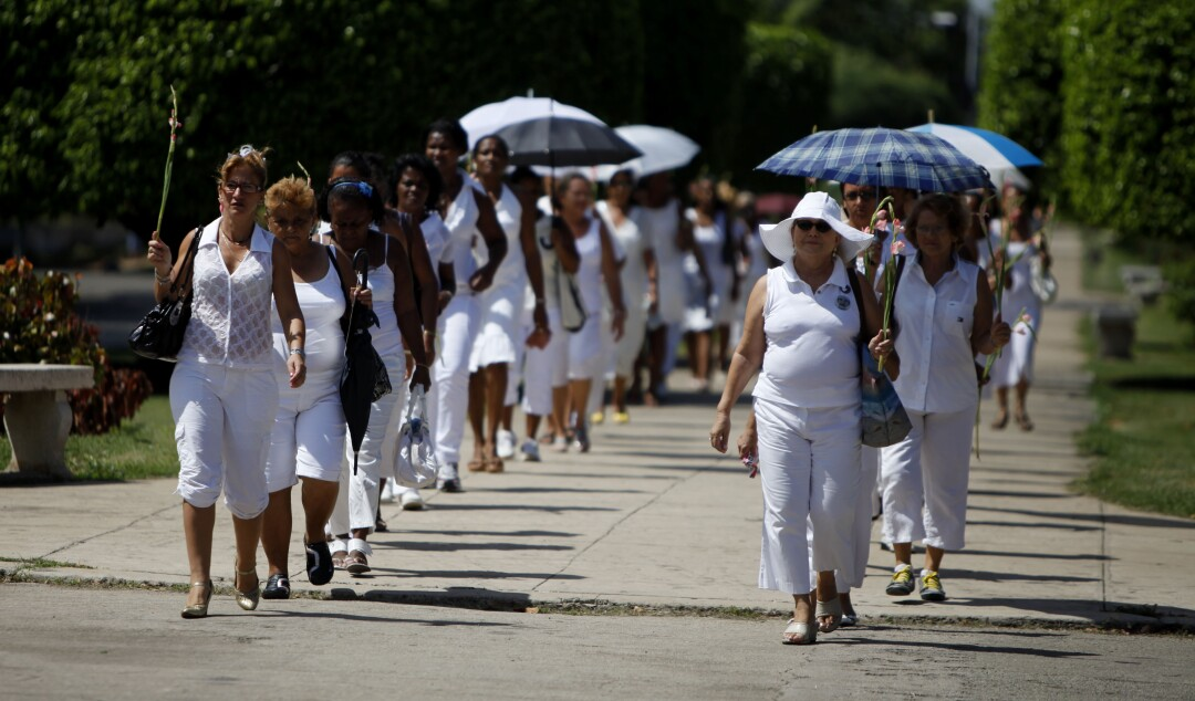 Members of the Cuban female dissident group Ladies in White demonstrate during their weekly march in Havana in 2010.