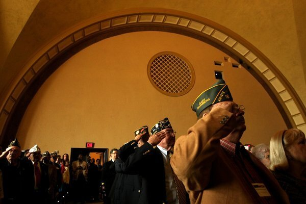 Veterans salute during the Posting of Colors at the rededication ceremony for Bob Hope Patriotic Hall in Los Angeles.