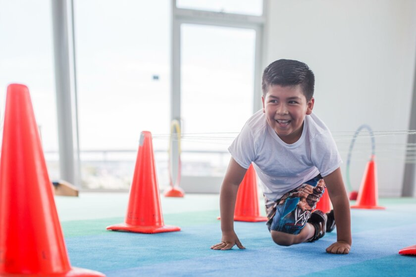 Daniel Valentino Gonzales goes through the obstacle course during the Olympic Rowing Day Ribbon Cutting Ceremony at the National City Aquatic Center.