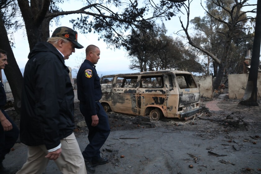 President Trump tours the Woolsey fire ravaged neighborhood on Dume Drive in Malibu on Nov. 17, 2018.