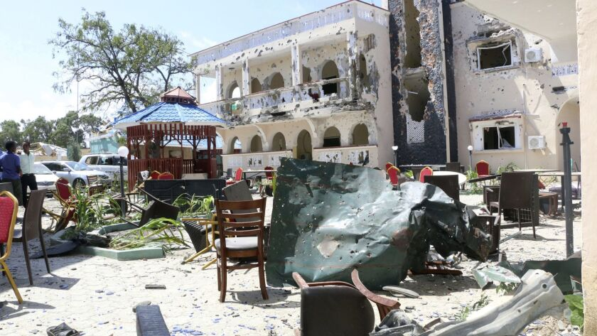 A view of Asasey Hotel after an attack, in Kismayo, Somalia, Saturday July 13, 2019. At least 10 pe
