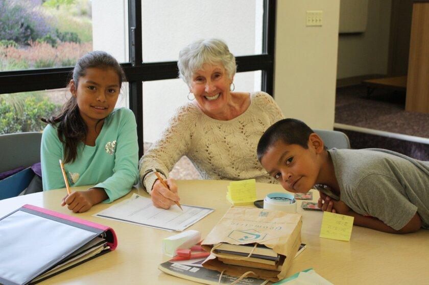 Casa de Amistad students with a volunteer