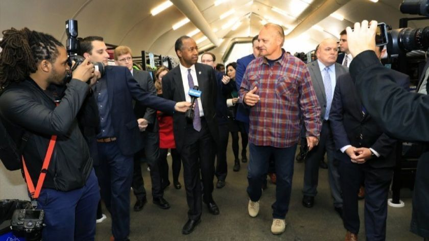 U.S. Department of Housing and Urban Development has proposed a rule change that prohibit unauthorized immigrants from living in federally subsidized housing. HUS Secretary Ben Carson is shown above touring the Alpha Project bridge shelter tent in San Diego last February.
