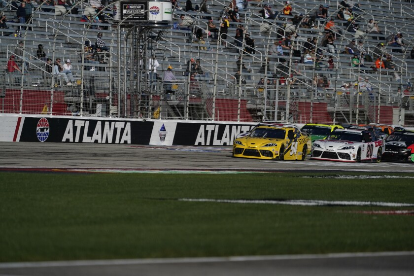 FILE - Martin Truex Jr. drives leads during a NASCAR Xfinity Series at Atlanta Motor Speedway in Hampton, Ga., in this Saturday, March 20, 2021, file photo. After putting off the inevitable project as long as possible, Atlanta Motor Speedway officials, including track president Brandon Hutchinson, on Tuesday, July 6, announced plans to resurface the worn-out track following Sunday's NASCAR race. (AP Photo/Brynn Anderson, File)