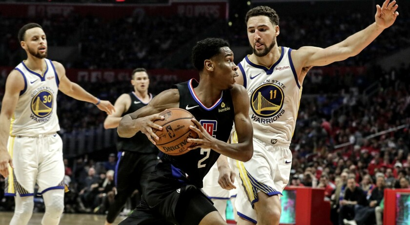 LOS ANGELES, CA, SUNDAY, APRIL 21, 2019 - Clippers guard Shai Gilgeous-Alexander drives past Warrior