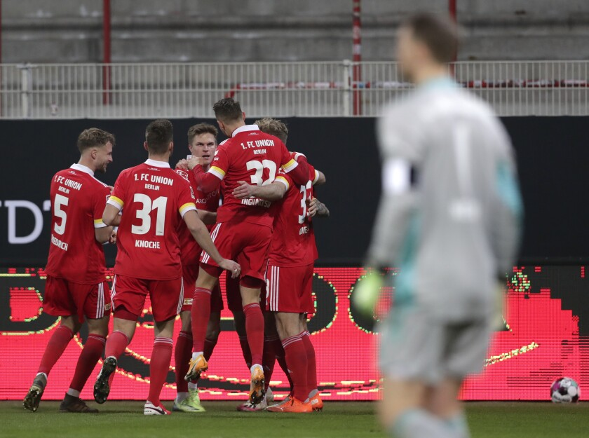 Union's Grischa Proemel celebrates with teammates after scoring his sides first goal during the German Bundesliga soccer match between 1.FC Union Berlin and FC Bayern Munich in Berlin, Germany, Saturday, Dec. 12, 2020. (AP Photo/Michael Sohn, pool)