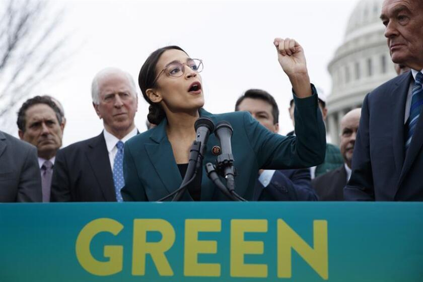 "Alexandria Ocasio-Cortez, a Democratic representative from New York (L); and Ed Markey, a Democratic senator from Massachusetts; speak to a crowd during a press conference to launch their ""Green New Deal"" in Washington, DC, USA, on Feb. 7, 2019. EPA-EFE/SHAWN THEW"