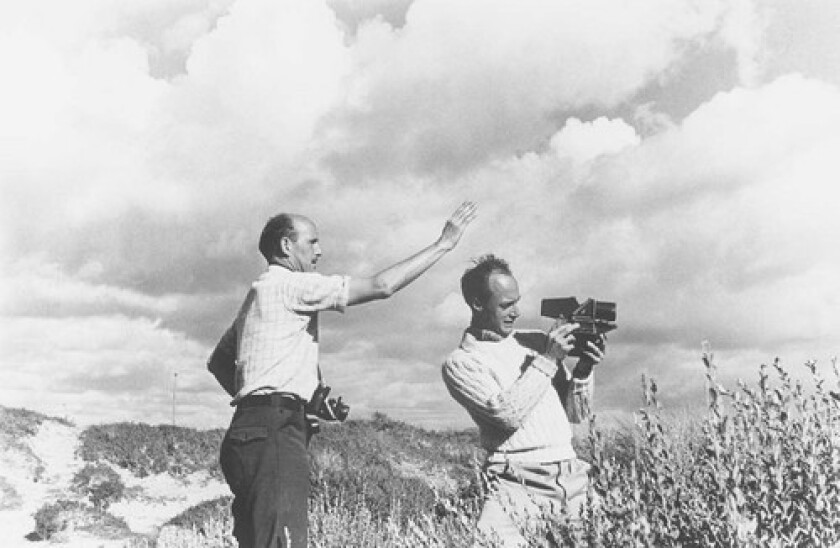 """Cinematographer Jack Cardiff, right, looks through the lens as director Michael Powell sets up a shot. Powell, who worked with Cardiff on """"The Red Shoes"""" and """"Black Narcissus,"""" called Cardiff """"the greatest color cameraman in the world."""" In a nearly 90-year career in cinema, Cardiff worked with directors such as Alfred Hitchcock and King Vidor, and stars such as Humphrey Bogart and Ava Gardner."""
