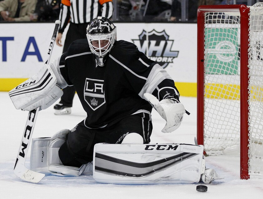 Kings goalie Jhonas Enroth makes a pad save against the Islanders during a game on Nov. 12.