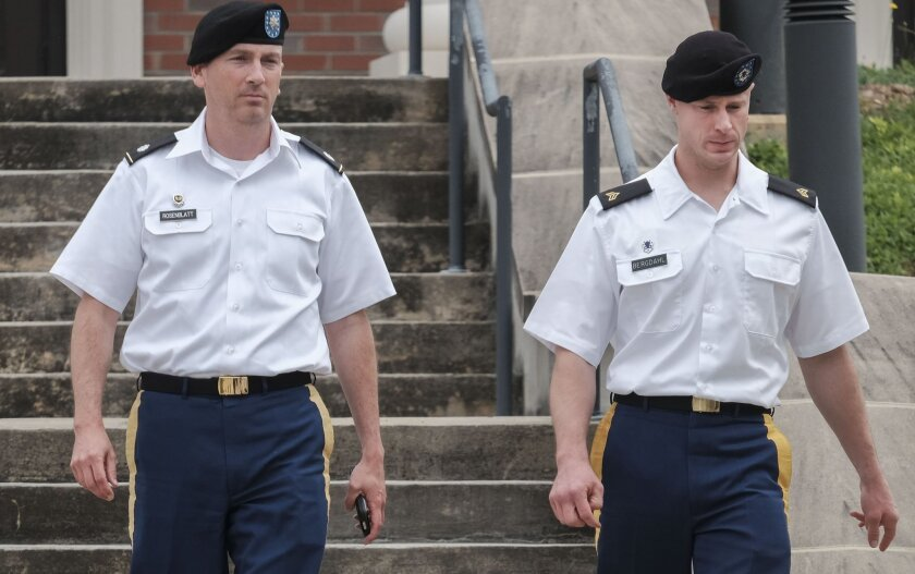 Lt. Col. Frank Rosenblatt, left, and Sgt. Bowe Bergdahl leave the court room for the lunch break on Monday, Aug 22, 2016, at Fort Bragg, N.C. Attorneys for Bergdahl are scheduled to argue Tuesday that decision-makers with power over the soldier's prosecution were improperly swayed by negative comments from U.S. Sen. John McCain. (Raul R. Rubiera/The Fayetteville Observer via AP)