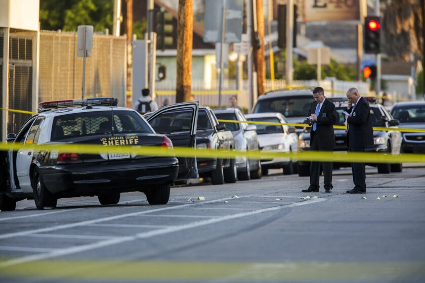 Detectives investigate the fatal shooting of a man by Los Angeles County sheriff's deputies at Holmes Avenue and 64th Street in the Florence-Firestore area.