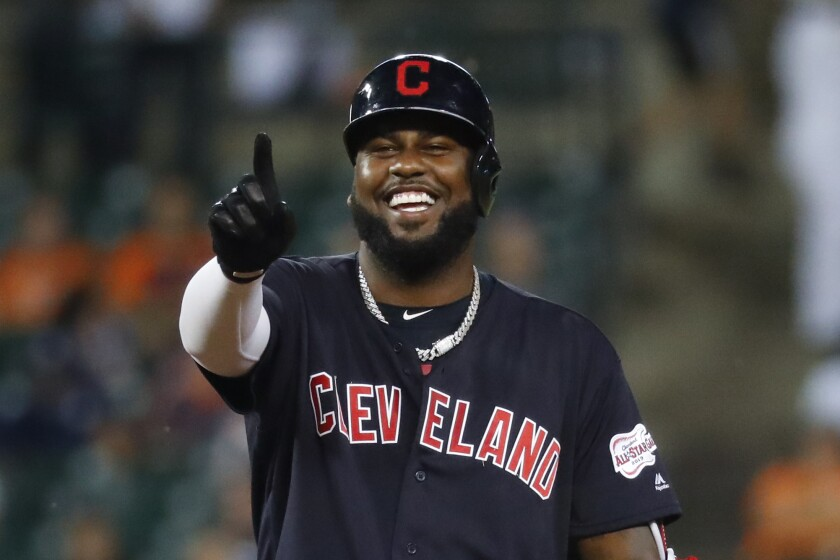 Cleveland Indians' Franmil Reyes gestures to the dugout after hitting a double in the sixth inning of a baseball game against the Detroit Tigers in Detroit last month.