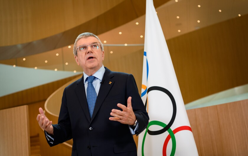 International Olympic Committee President Thomas Bach delivers a statement on the COVID-19 situation during a meeting of the executive board at IOC headquarters in Lausanne, Switzerland, on Tuesday.