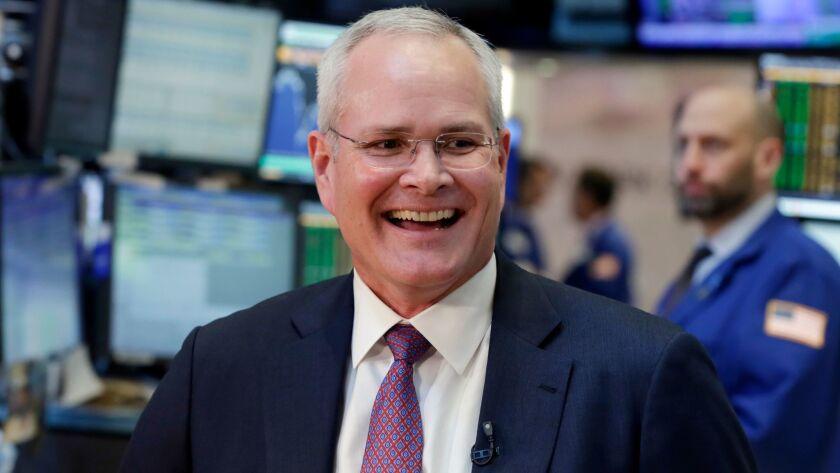 Exxon Mobil CEO Darren Woods visits the New York Stock Exchange last week.