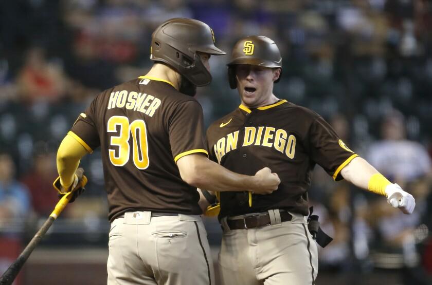 Jake Cronenworth celebrates with Eric Hosmer after hitting a two-run homer