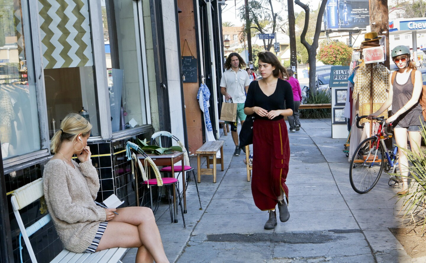 """Shoppers explore Echo Park Avenue. """"People who are attracted to Echo Park are looking for a little bit of magic,"""" said shoe designer Beatrice Valenzuela. """"They want something exciting, not perfect or pristine."""""""