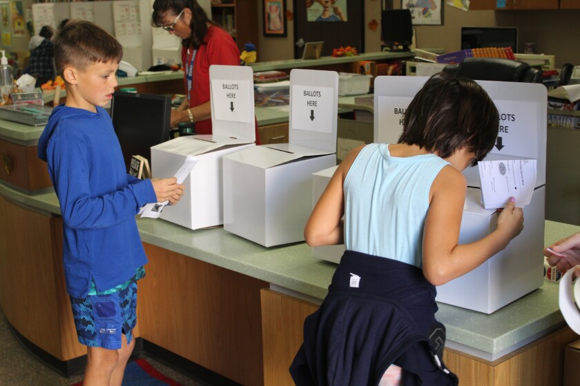 A student makes sure her vote counts.