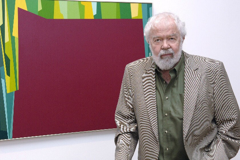 "Artist Karl Benjamin shown with his work ""Interlocking Forms (Big Magenta with Green)."""