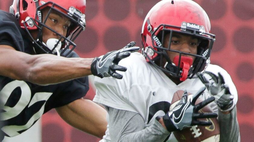San Diego State safety Kyree Woods (right) suffered a torn right ACL in Saturday night's victory at Colorado State.