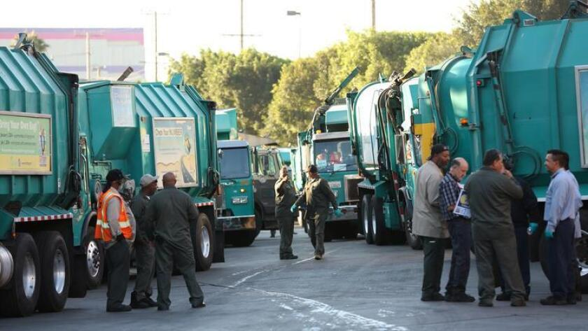 Sanitation workers gather last month at a demonstration in Boyle Heights over stalled contract negotiations.