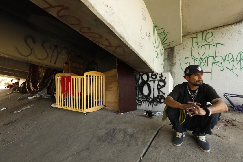 Manuel Pajar, 40 sits near his camp under an overpass during the 2019 Greater Los Angeles Homeless Count in the City of Commerce on Thursday. Pajar has been homeless for the past 9 years.