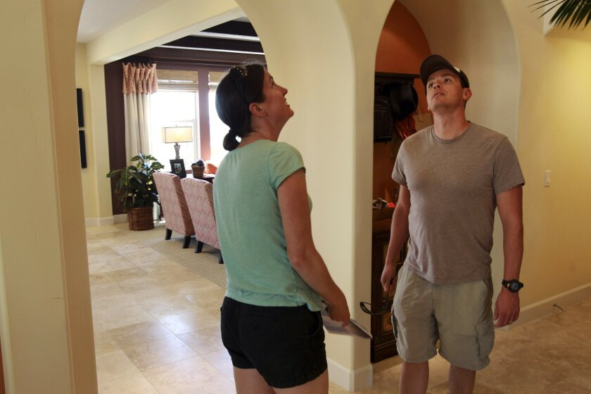 Jake and Leah Malish look at one of the model homes at a Pardee Homes community, called Watermark, in Carmel Valley on a Sunday in April.
