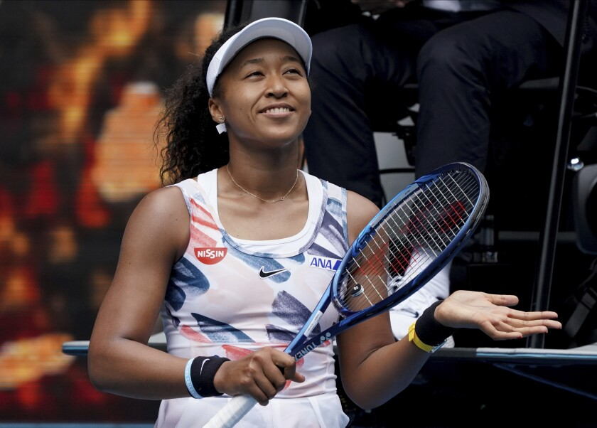 Naomi Osaka celebrates after defeating Marie Bouzkova in a first round singles match Jan. 20 at the Australian Open.