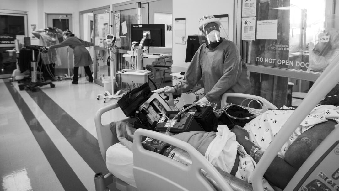 Nurse Quinnece Washington rushes a COVID-19 patient into the intensive care unit.