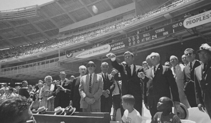 President John F. Kennedy throws out the first pitch before the 1962 All-Star Game played in Washington, D.C.