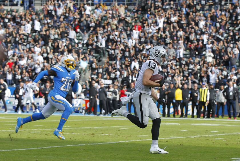 Oakland Raiders receiver Hunter Renfrow runs in for touchdown in second quarter as Los Angeles Chargers cornerback Desmond King II trails on Sunday in Carson.