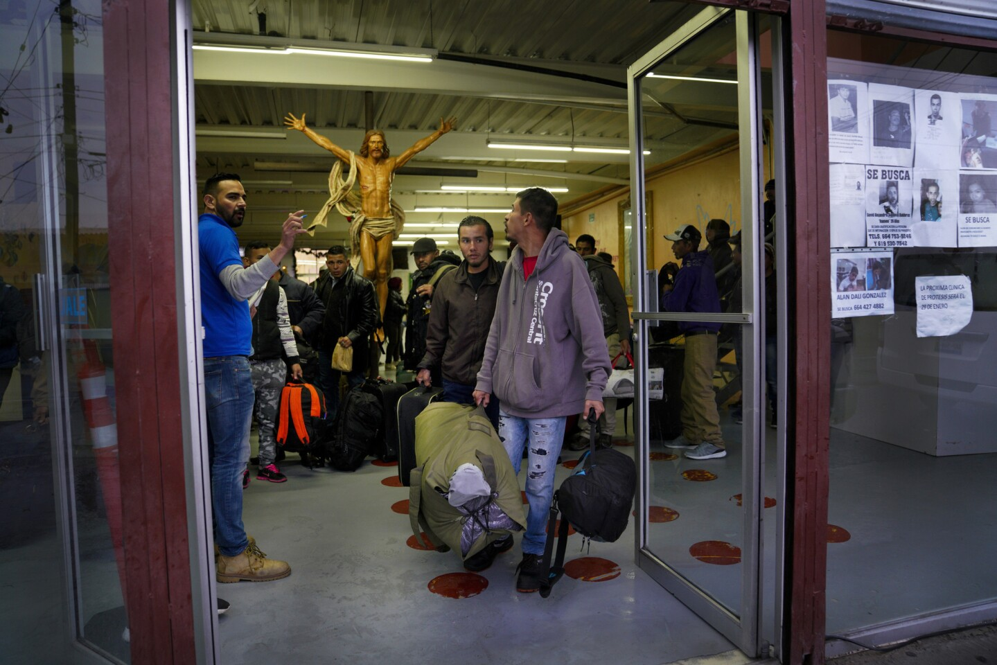 Late afternoon on Tuesday, an official from the International Organization for Migration gives transportation instructions to the group of 32-men and 3 women at the Desayunador Salesiano Padre Chava shelter in Tijuana that have volunteered to return back to their home countries.