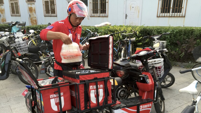 He Zhigang, a 29-year-old from Henan province, is a wai mai, or take-out, driver.