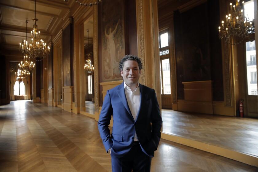Venezuelan conductor Gustavo Dudamel poses after a press conference at the Palais Garnier opera house, in Paris Friday, April 16, 2021. The Paris Opera announced the arrival of Gustavo Dudamel as music director for six seasons. (AP Photo/Christophe Ena)