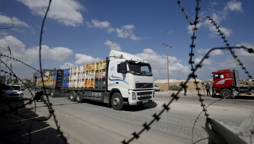 A truck carrying goods to Palestinians arrives at Kerem Shalom crossing in Rafah in the southern Gaza Strip on Aug. 15, 2018. Israel reopened the only commercial crossing into the Gaza Strip in response to relative calm on the border after months of tensions prompted a blockade.