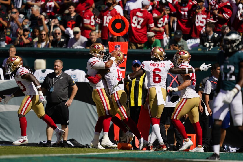 San Francisco 49ers wide receiver Jauan Jennings (15) celebrates his touchdown with teammates during the first half of an NFL football game against the Philadelphia Eagles on Sunday, Sept. 19, 2021, in Philadelphia. (AP Photo/Matt Slocum)