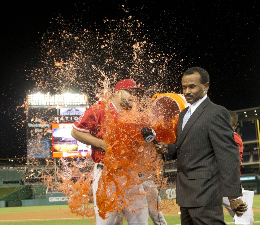 Jose Mota interviews Angels slugger Albert Pujols, who gets a celebratory shower after hitting caree