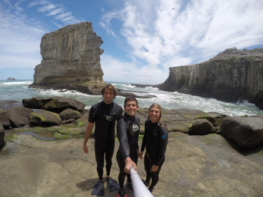 Del Mar Lifeguards Brodie Martin, Trevor Colbert and Madeline Crosby at Muriwai Beach in New Zealand.