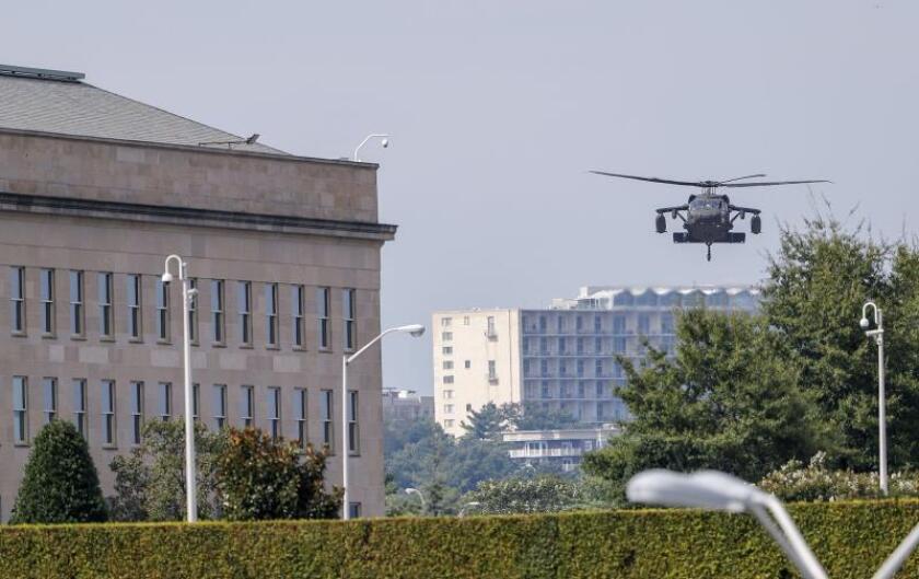 A military helicopter lands outside the Pentagon building in Arlington, Virginia, USA, Oct. 2, 2018. EPA-EFE FILE/ERIK S. LESSER