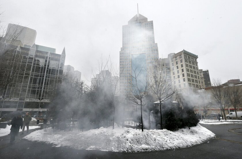 "Machine-generated fog that's part of ""A Winter Landscape Cradling Bits of Sparkle"" by artist Jennifer Wen Ma, wafts over the installation in Pittsburgh's Market Square on Thursday, Feb. 26, 2015. The Pittsburgh Post-Gazette says firefighters have been called to the location at least twice, including once Thursday morning, by people who mistook machine-generated fog that's part of a new art installation for smoke. (AP Photo/Keith Srakocic)"