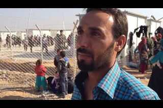 Families displaced by fighting in Mosul flee to camps outside the city