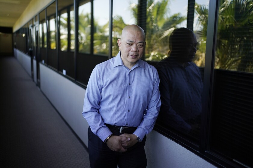 Sonny Vinuya poses for a portrait Tuesday, July 7, 2020, in Las Vegas. Vinuya, a Filipino-American businessman in Las Vegas, hasn't decided if he'll vote again for Donald Trump in the battleground state of Nevada. (AP Photo/John Locher)