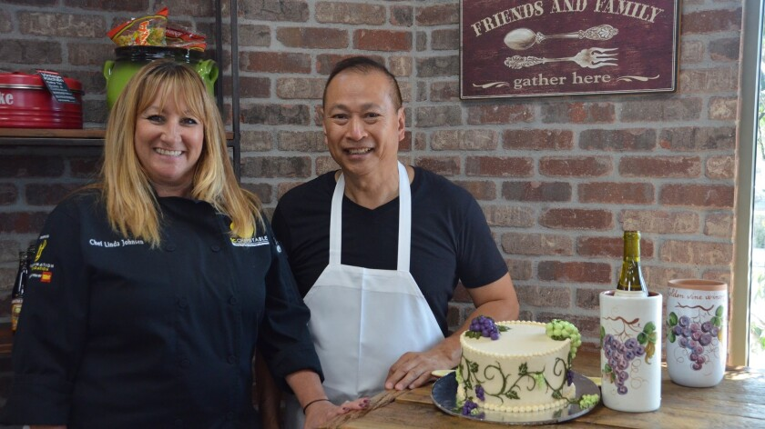 Executive chef and owner of Filomena's, Linda Johnsen poses with in-house baker, Thuan Pham alongsid
