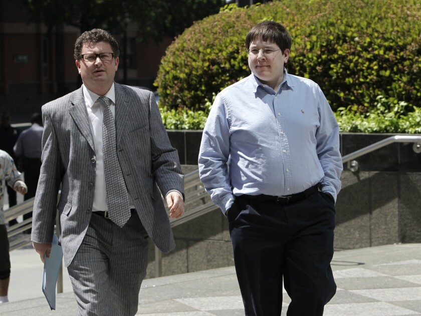 In this April 23, 2013, file photo, Matthew Keys, right, walks to the federal courthouse in Sacramento for his arraignment with his attorney Jason Leiderman.