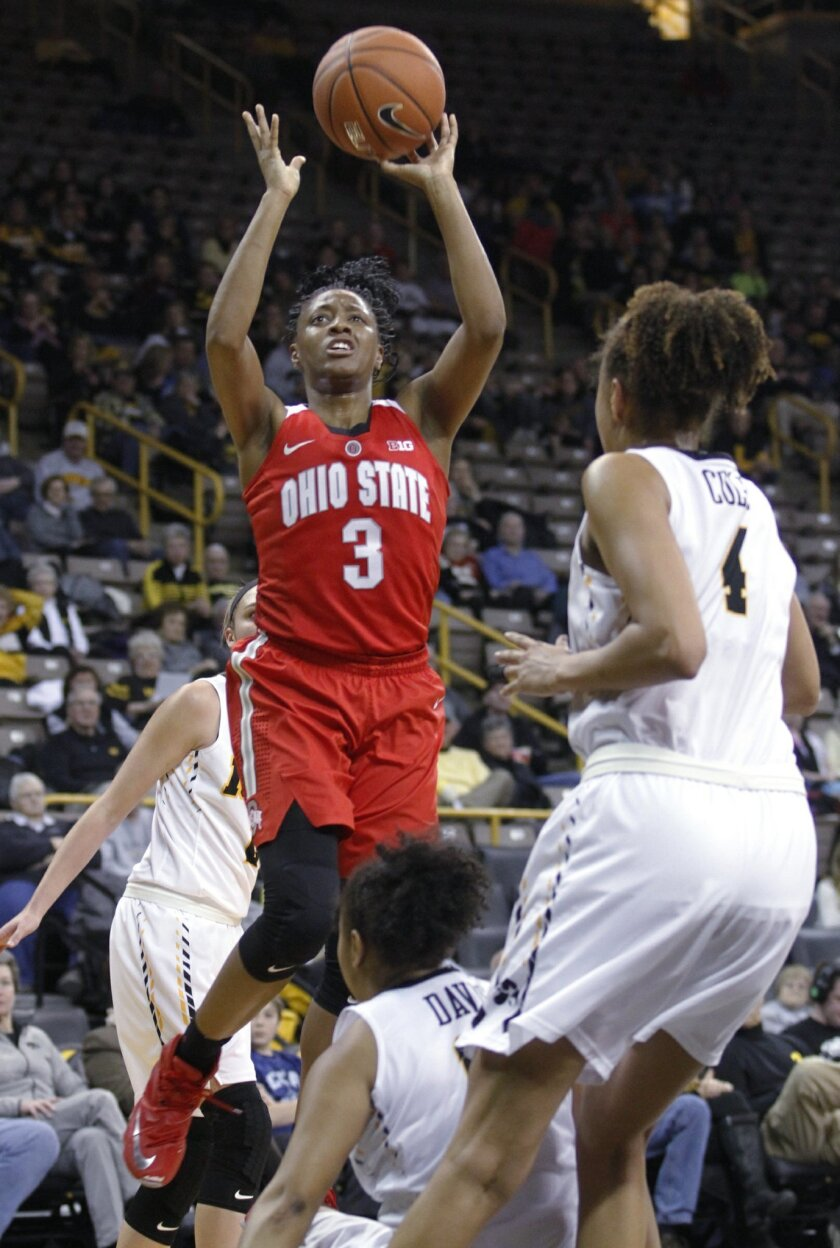 Ohio State guard Kelsey Mitchell (3) goes to the basket against Iowa guard Tania Davis, bottom, during the first half of an NCAA college basketball game in Iowa City, Iowa, Thursday, Feb. 11, 2016. (AP Photo/Matthew Holst)