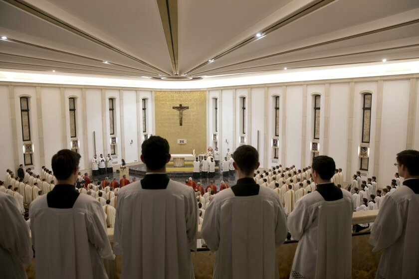Prelates attend a mass celebrated by Cardinal Velasio De Paolis at the Legion's main headquarters, the Ateneo Pontificio Regina Apostolorum, in Rome, Wednesday, Jan. 8, 2014. The mass marks the opening of the Legion of Christís General Chapter, the month-long meeting where theyíre going to approve