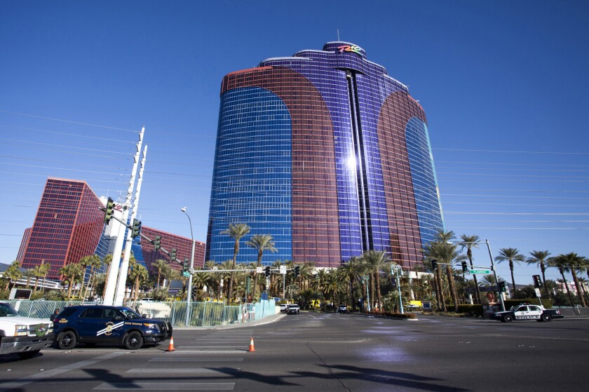 NHP and Metro Police officers block off the entrance off Flamingo Road to the Rio Hotel & Casino after reports of smoke coming from the 21st floor of the Masquerade Tower led to guests being evacuated Thursday, Dec. 29, 2016.