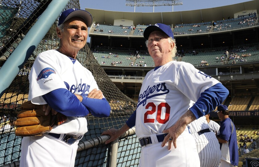 Dodgers pitching greats Don Sutton, right, and Sandy Koufax talk before an old-timers game at Dodger Stadium in June 2013.
