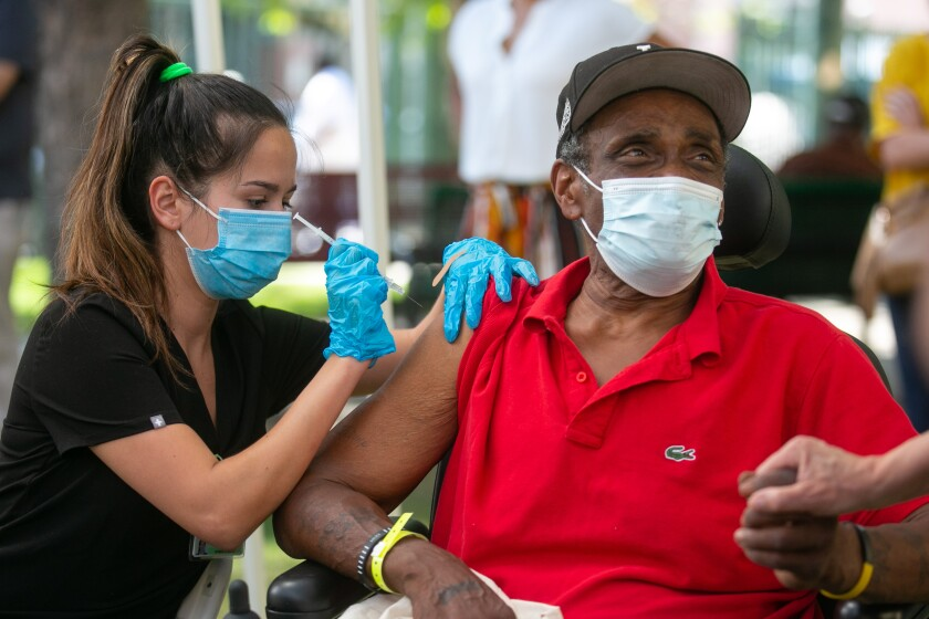 A man receives a COVID-19 vaccine.