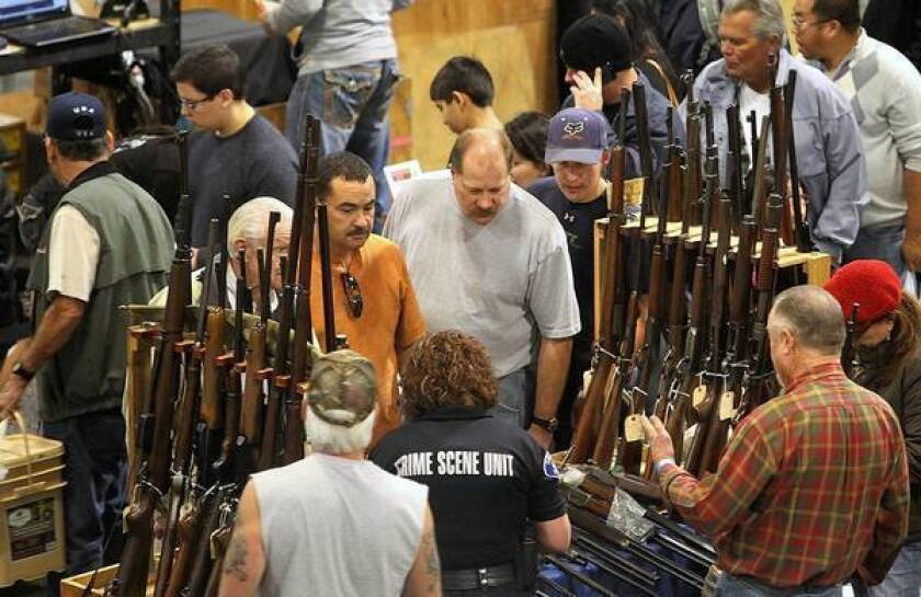 California's firearms-related deaths per 100,000 people have consistently fallen as regulations have increased. Above, a gun show in Ontario last month.