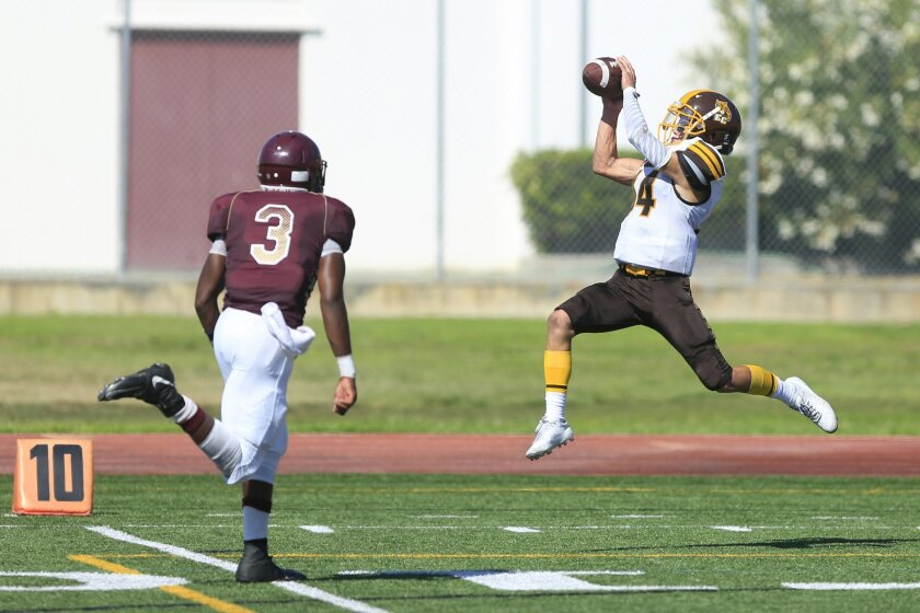 El Camino's John Armentrout catches a 39-yard touchdown pass in Saturday's win over Point Loma.